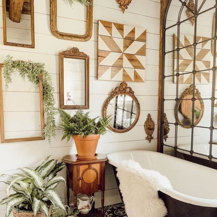 Decorating With Barn Quilts by Fleur At Home with a barn quilt hanging in a bathroom