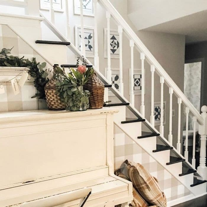 Decorating With Barn Quilts by Our Simple Hectic Home with barn quilts hanging up a staircase