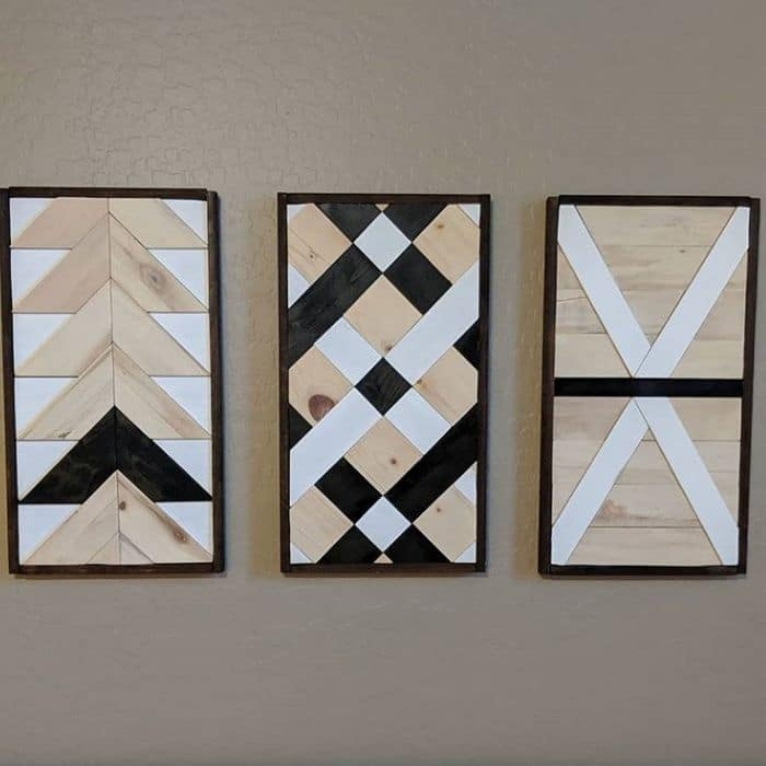 Decorating With Barn Quilts by I Totally Have A Workshop with a set of three barn quilts hanging