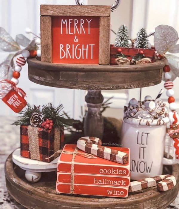 Christmas Tiered Trays by Our Nest Decor with wooden mini stamped books and more on this tiered tray