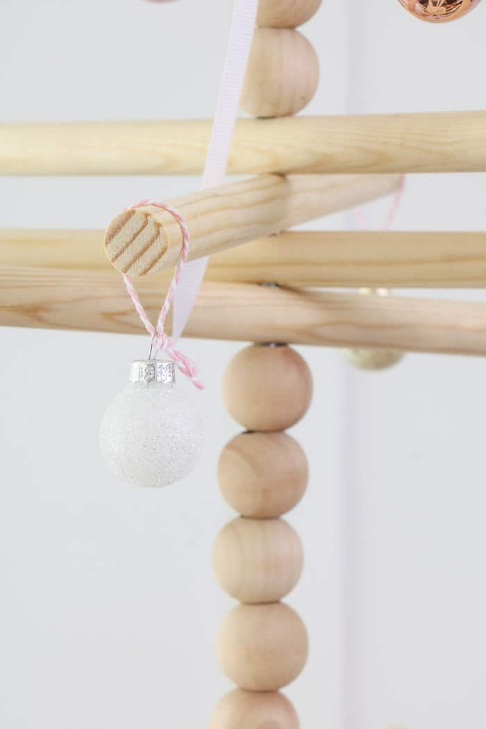 Wooden dowel Christmas tree designed for the kitchen with gingerbread ornaments.