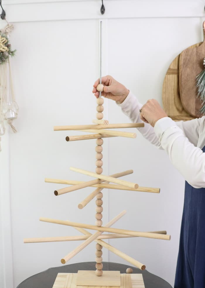 Wooden dowel Christmas tree designed for the kitchen with gingerbread ornaments. Then wooden balls