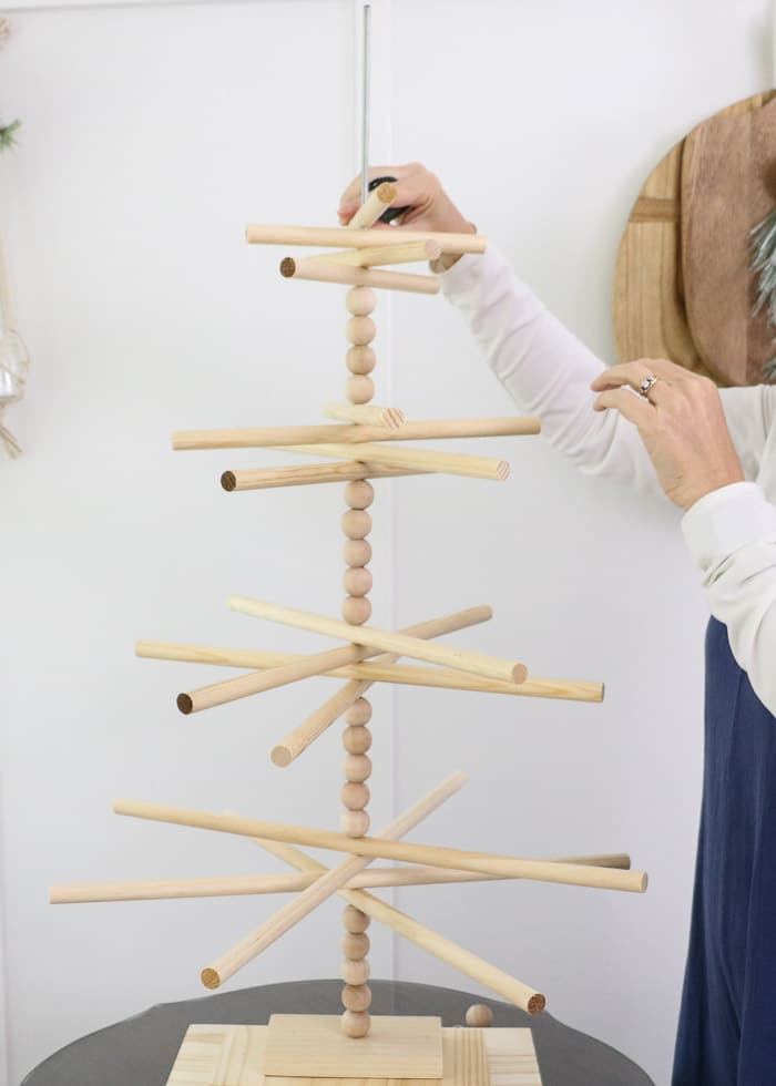 Wooden dowel Christmas tree designed for the kitchen with gingerbread ornaments. Then wooden dowels