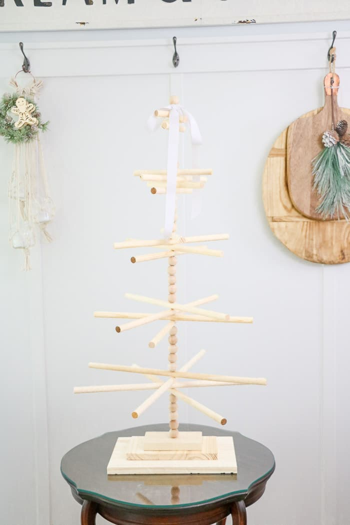 Wooden dowel Christmas tree designed for the kitchen with gingerbread ornaments. Finished tree