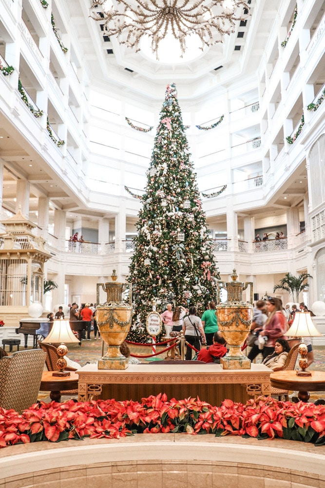 Victorian Christmas inspiration at Disney Grand Floridian with a 40' tall tree in the lobby adorned with large velvet bows, glass balls, birdcages, swans and much more.