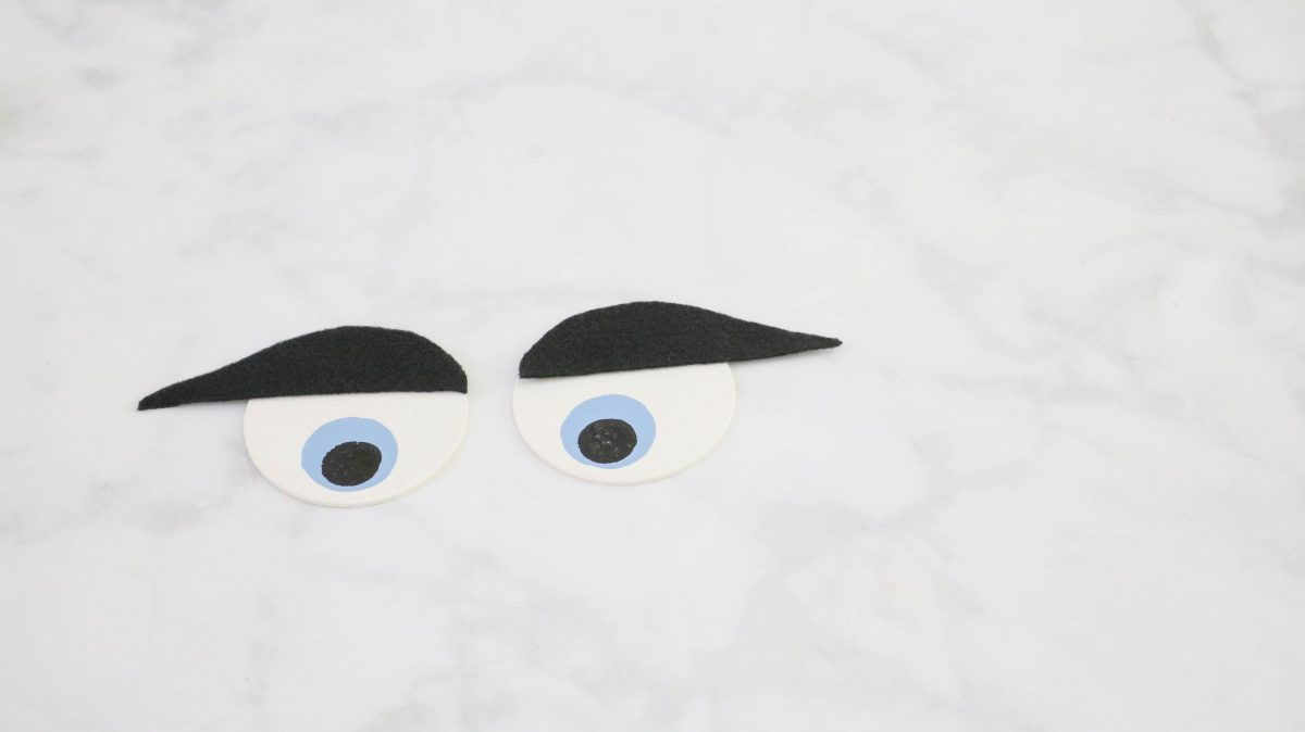 DIY life size nutcracker by making eyebrows for the eyes.