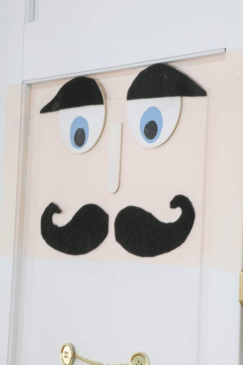 DIY life size nutcracker by gluing down the face of the soldier.