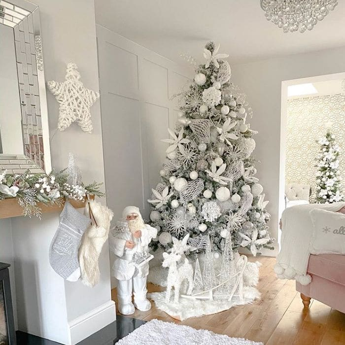 White Christmas Light Ideas by Forest House Home Styling with a white decorated Christmas tree with touches of silver