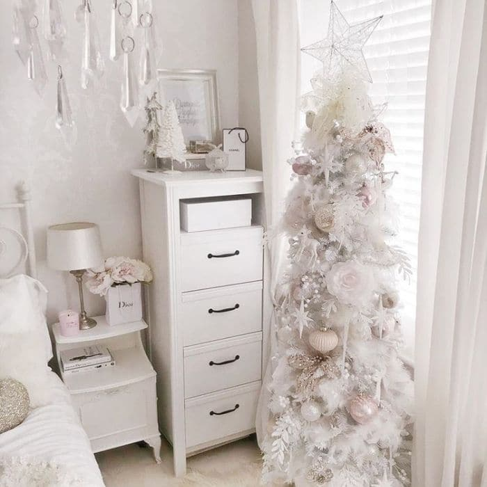 White Christmas Tree Decor by Fabulously Exhausted with pink and white Christmas tree decor in a bedroom