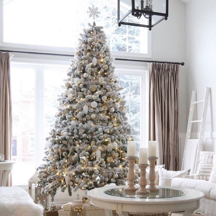 White Christmas Tree Ideas by Willow Bloom Home Blog featuring a white with gold accents on a white Christmas tree
