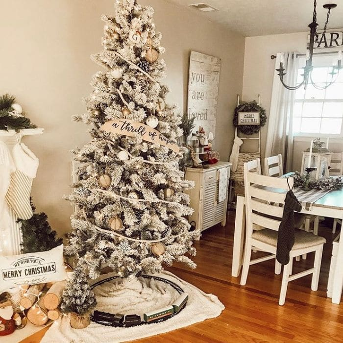 White Christmas Tree Ideas by Down Home Grace with a banner trimming a white decorated tree