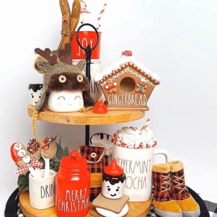 Decorating With Gingerbread Houses by Buttermilk Chic By Wendy with a gingerbread house on a tiered tray with lots of other goodies
