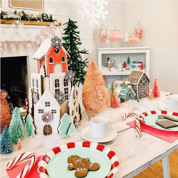 Decorating With Gingerbread Houses by The Revelry Co. with gingerbread houses as a table centerpiece