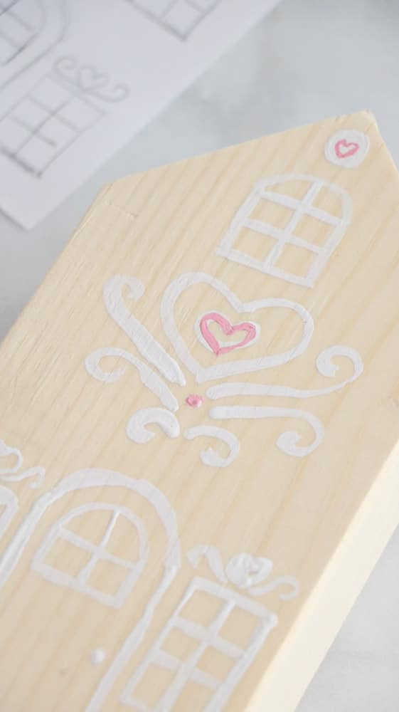 Paint pink hearts and some dots on your 2 x 4 Valentine wooden gingerbread houses