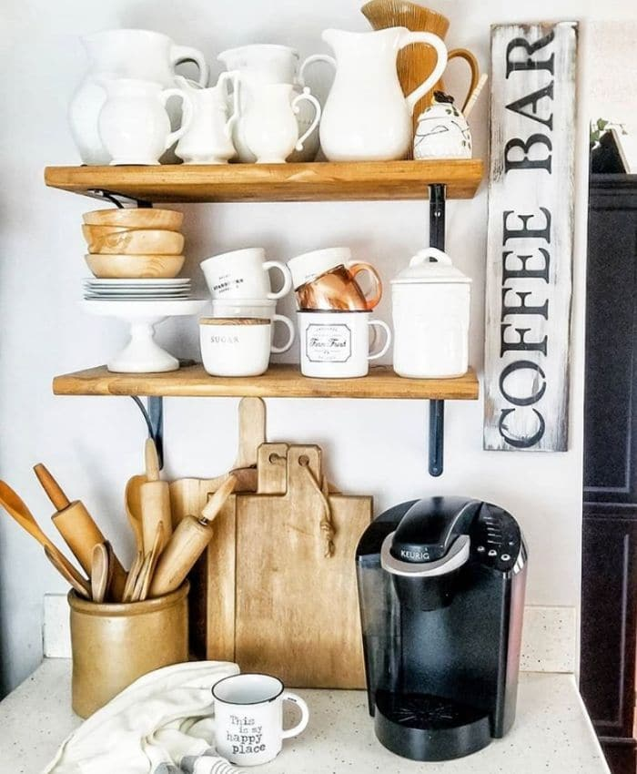 A coffee bar with wood pieces by The Crows Nest Sign Co.