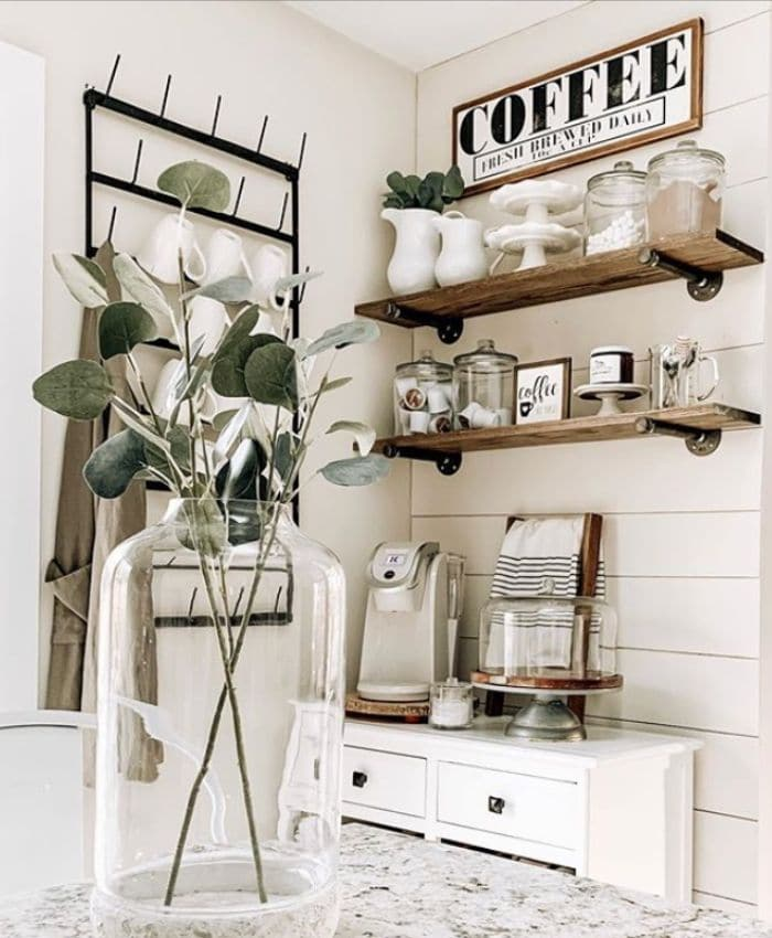 A coffee bar with floating shelves by Oak Hill Farms