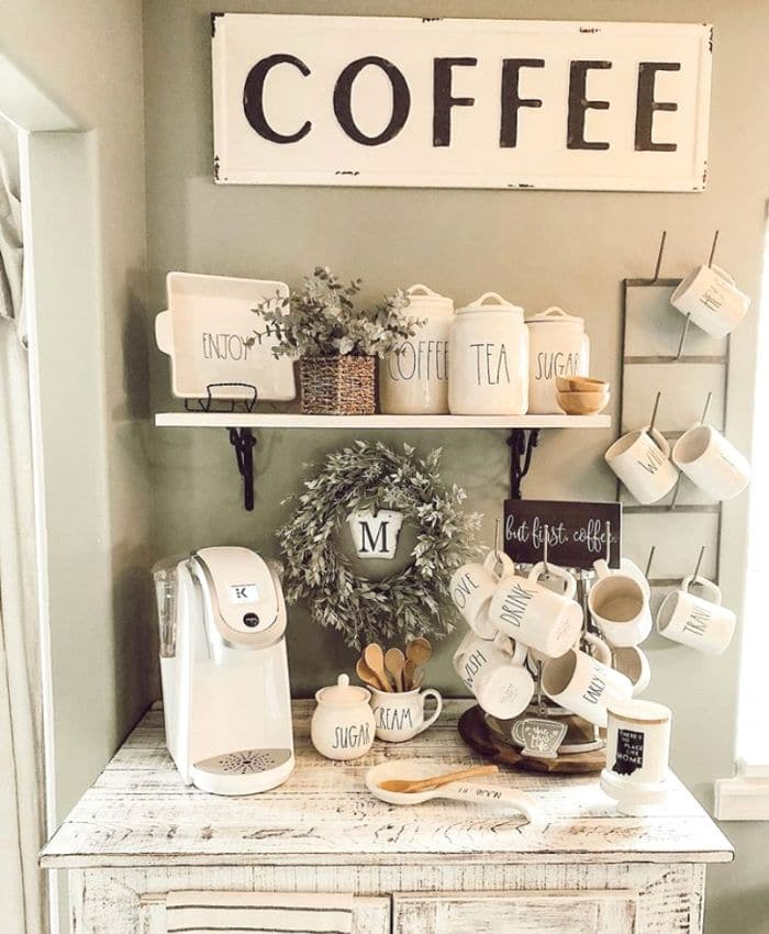 A rustic coffee bar with Rae Dunn pieces and a mug rack and mug tree from Little House on Prairie Cove