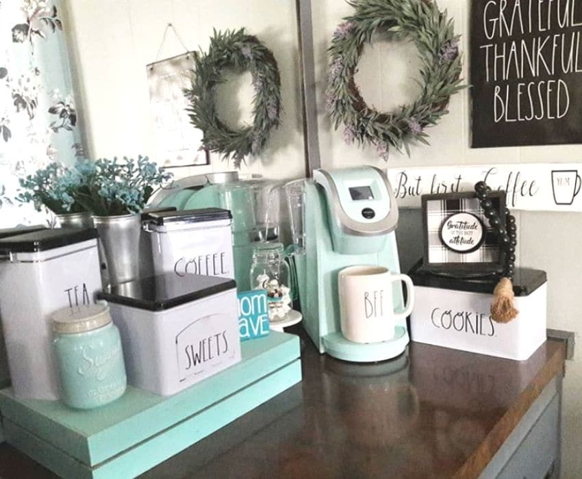A coffee bar with Rae Dunn tin storage by Luv Shades of Blue