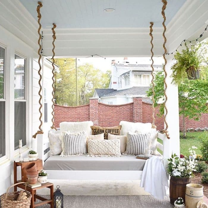 Porch Bed Swing Hanging from a Blue Ceiling from Simply Southern Cottage