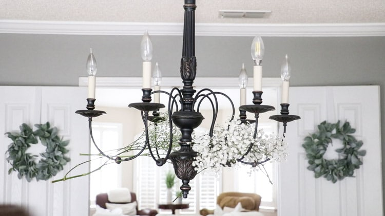 Add a second bundle of flowers to the next arm on the chandelier.
