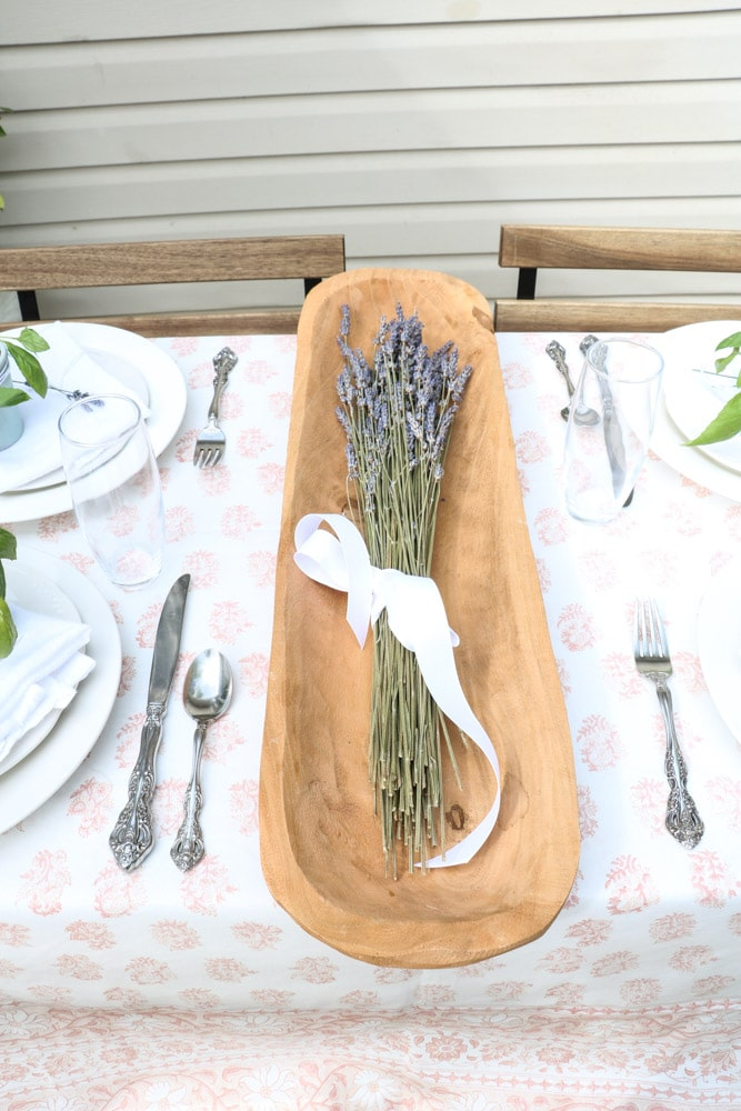 French country table setting centerpiece of lavender in a dough bowl