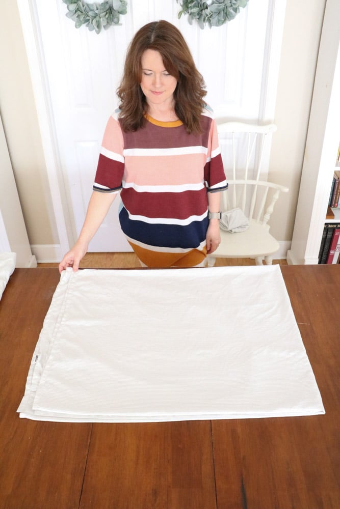 How to fold bed sheets neatly by folding the flat sheet the other way.