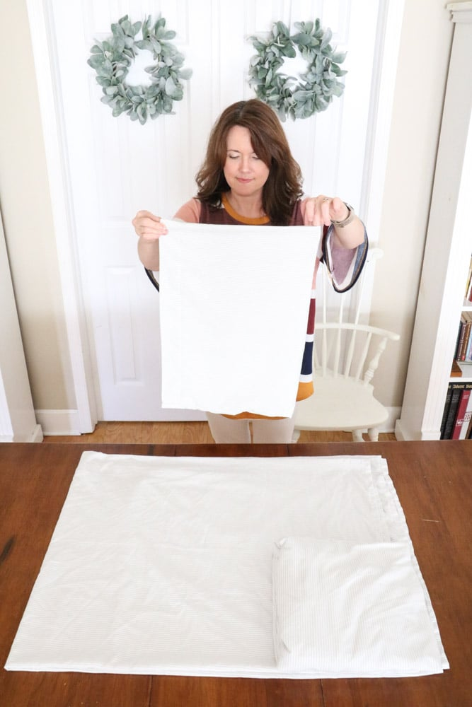 How to fold bed sheets neatly by folding the pillowcase in half