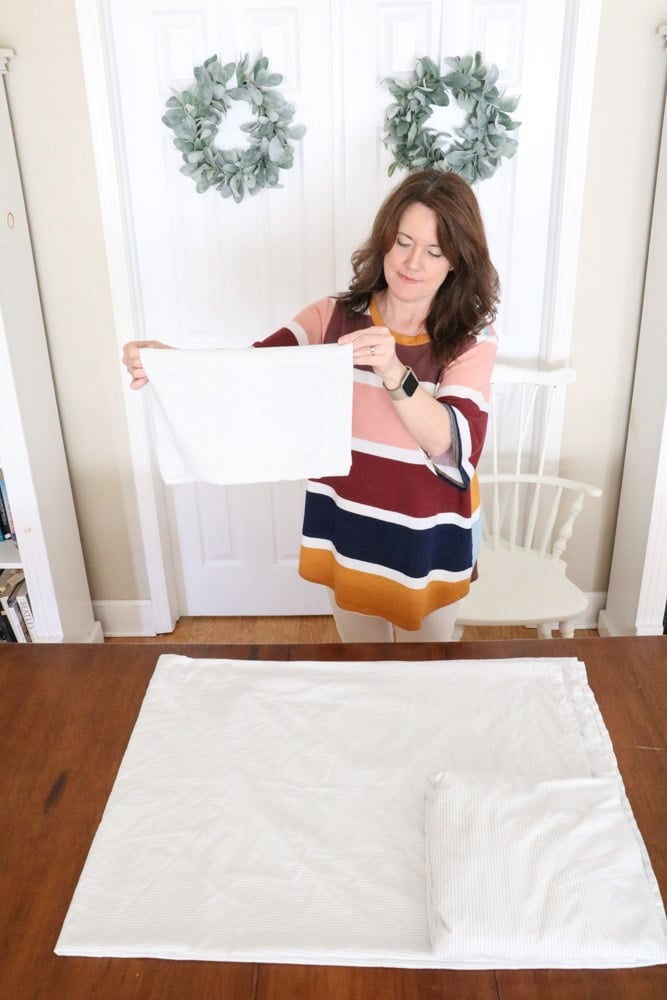 How to fold bed sheets neatly by folding the pillowcase another time.