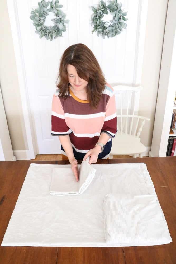 How to fold bed sheets neatly by folding the pillowcase again.