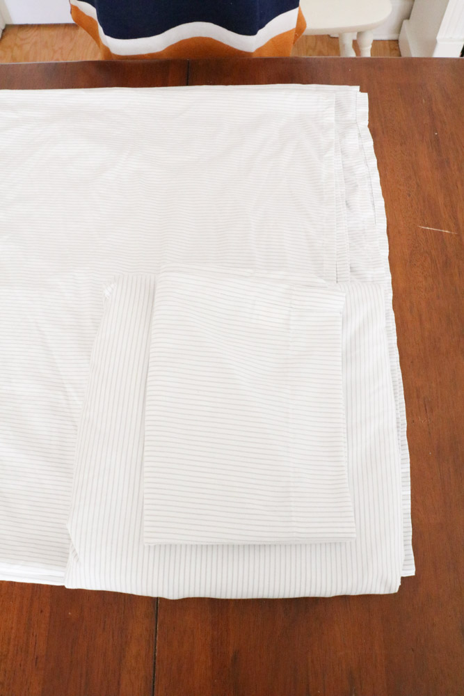 How to fold bed sheets neatly by sitting the pillowcase on top of the fitted sheet.
