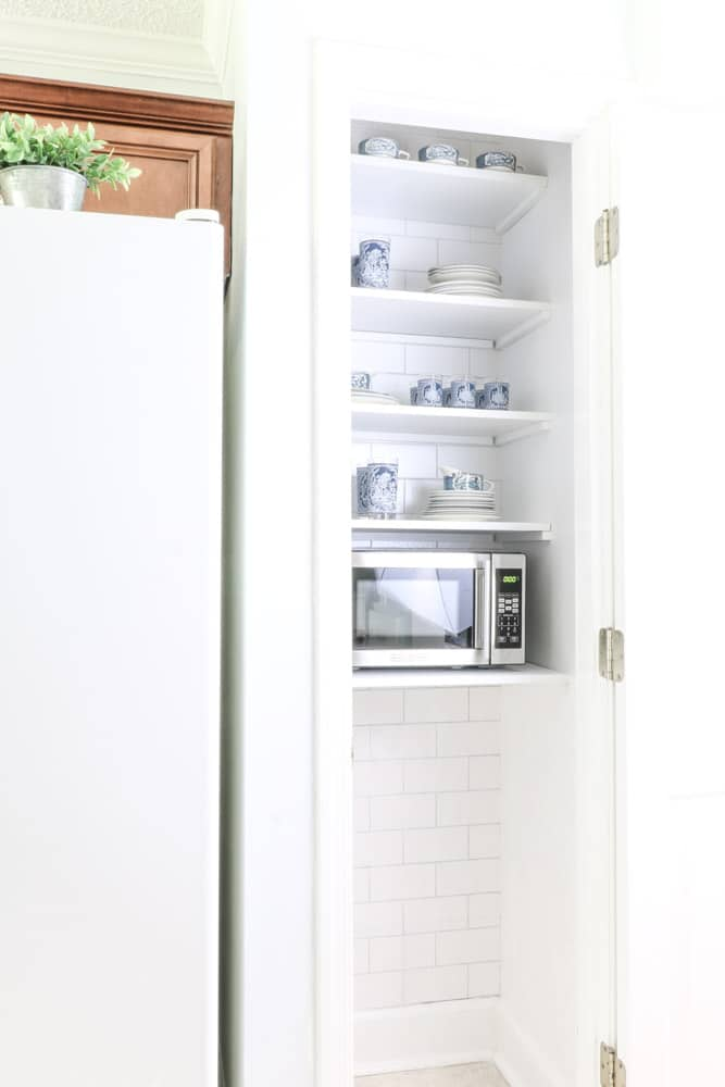 Microwave in pantry and a dish pantry too.