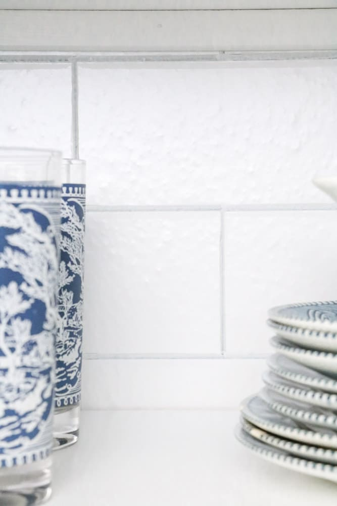 Dish pantry with subway tile wallpaper
