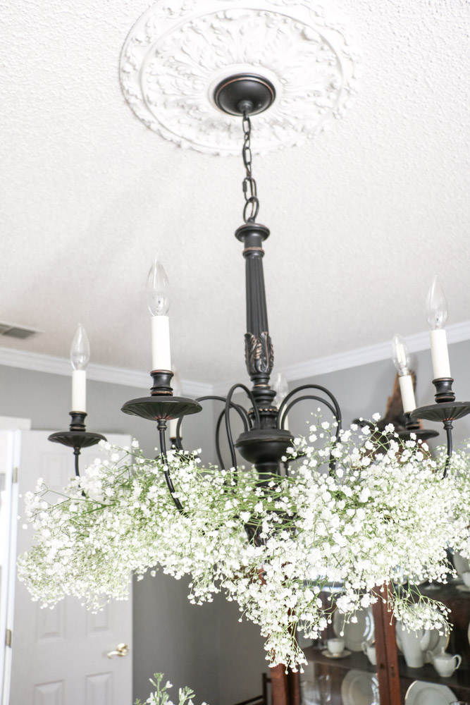 Flower arrangement on a chandelier of baby's breath for a Southern bridal shower.