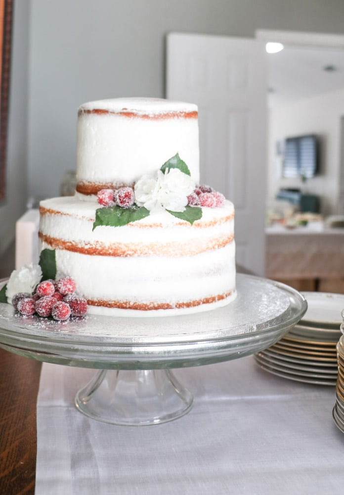 Two tiered naked cake with flowers for a southern bridal shower