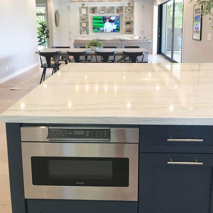 Microwave built into a kitchen island by Tim Lloyd Construction