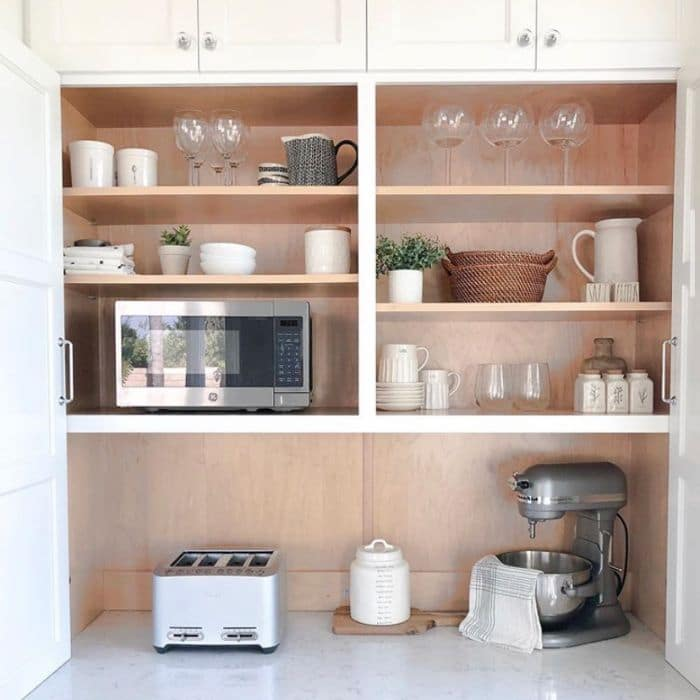 Stylish shelving with hidden microwave by My Hillside Haven