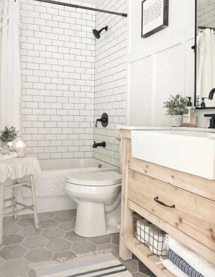 An apron sink in a small bathroom from The Sycamore Farmhouse