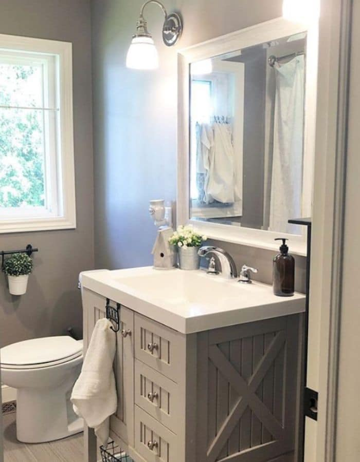 Tiny bathroom idea with a farmhouse sink cabinetry by Mandi Joy