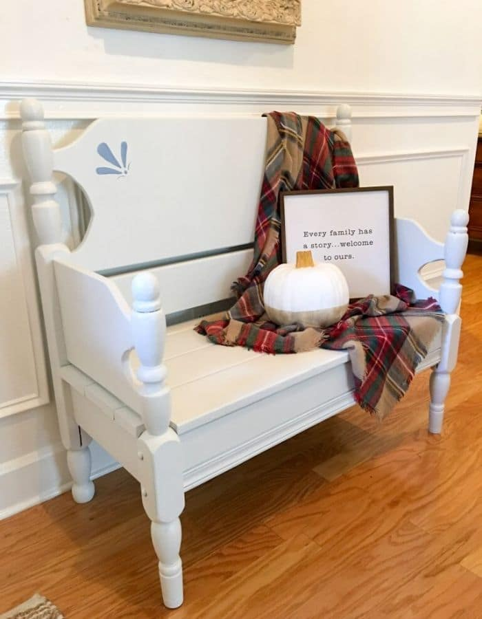 White spray paint twin bed turned into a bench DIY project.