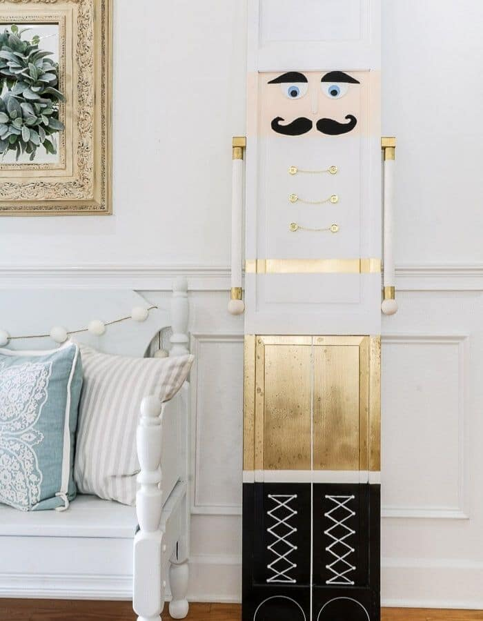 White and gold spray paint upcycled DIY Life Size Nutcracker