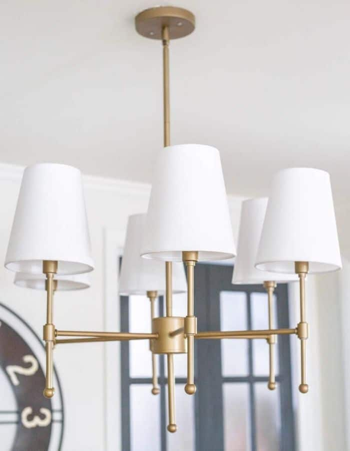 Spray painted chandelier makeover by Bless'er House