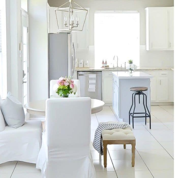Alabaster White on cabinetry and Thundercloud Gray on an Island by Julie Warnock Interiors