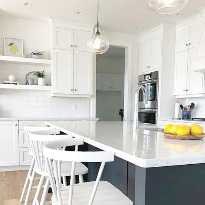 Sherwin Williams Pure White on cabinets and Cyberspace on the island by Kylie M. Interiors