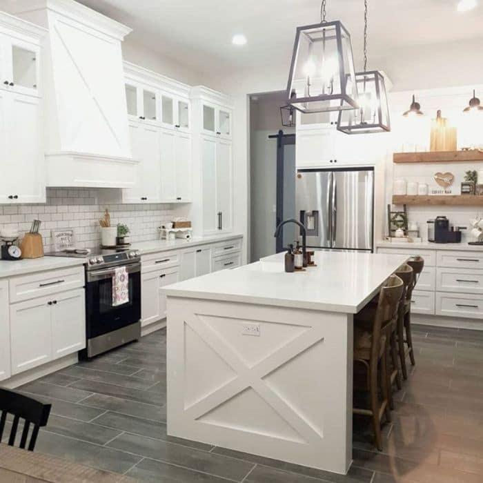 Snowbound painted kitchen cabinets & Agreeable Gray on the  walls.
