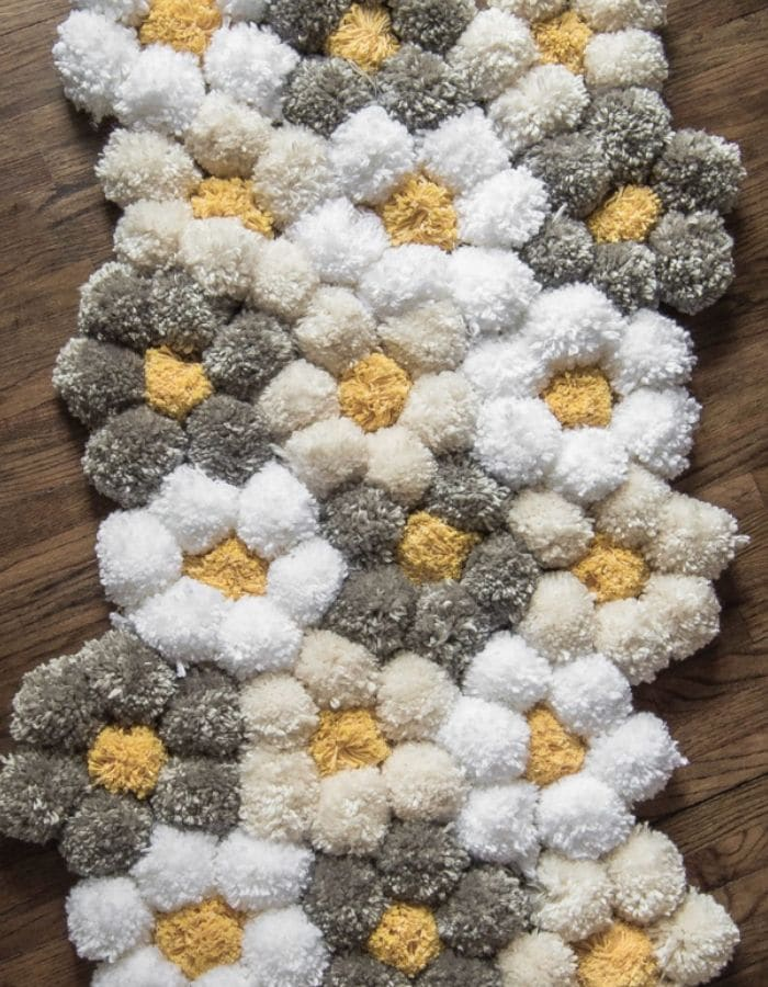 HOW TO MAKE A POM POM YARN RUG by Little Yellow Wheelbarrow