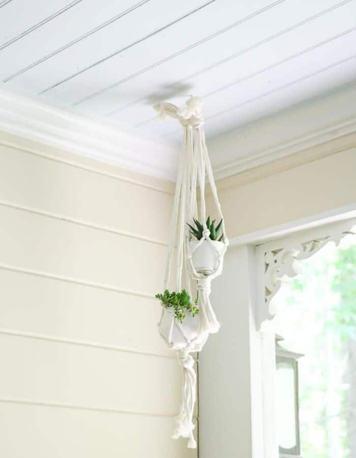 Porch ceiling painted in a satin finish with a macrame plant hanger.