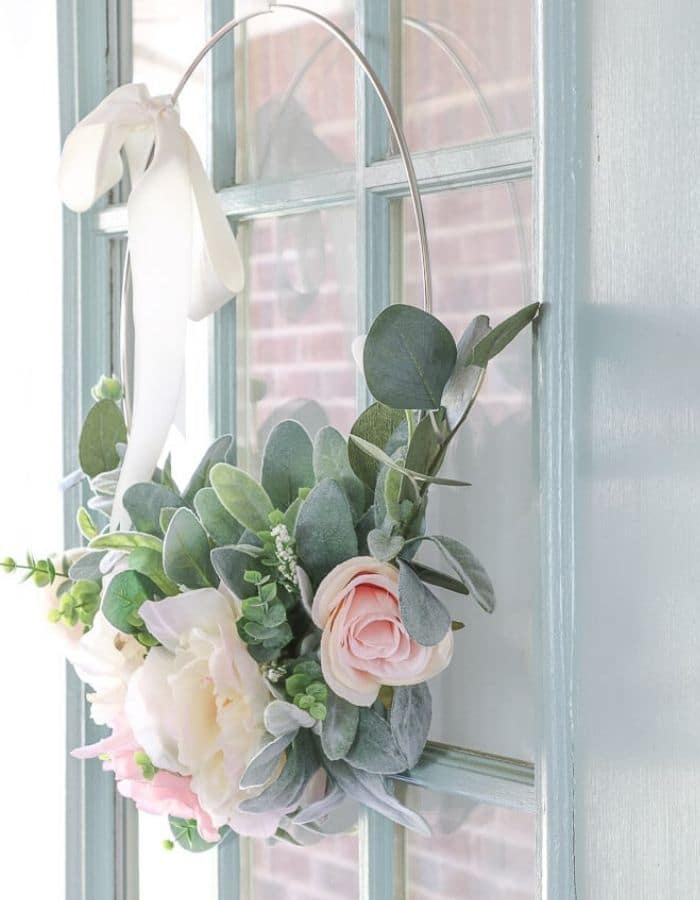 Front Door with a Semi-gloss finish in Wythe Blue by Benjamin Moore.  And a spring wire wreath with peonies, lambs ear leaves.
