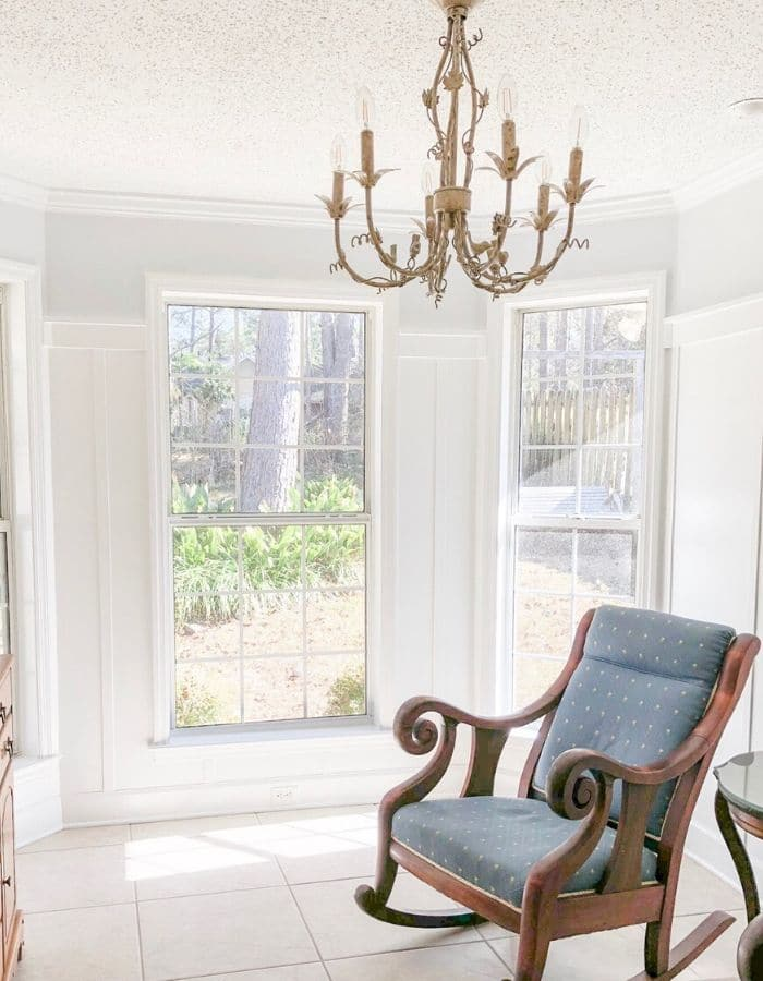 Rocking chair room with board and batton wainscot painted white in semigloss and pale blue on top in satin finish.
