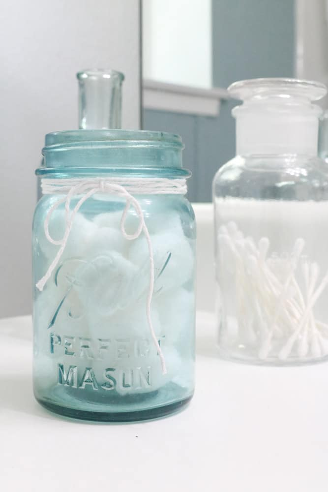 Antique blue mason jar filled with cotton balls