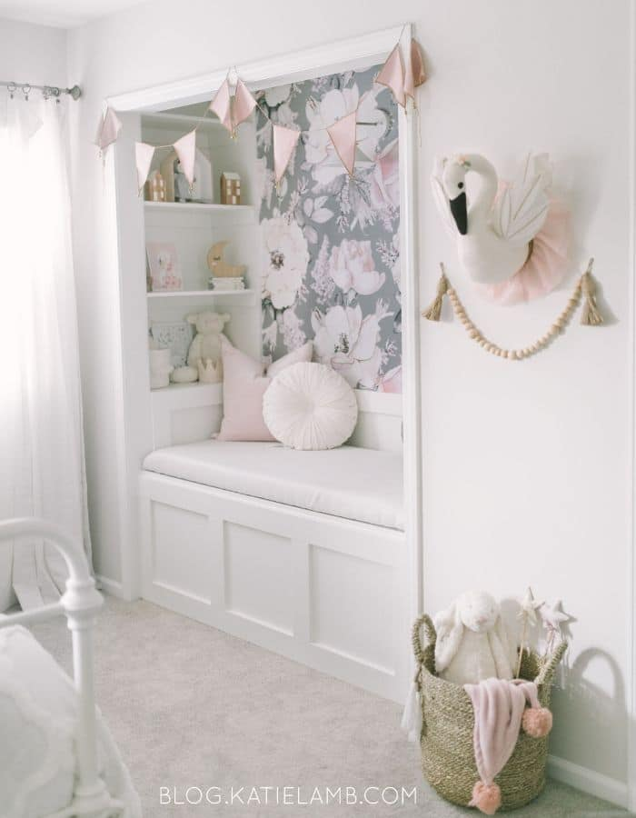 Toddler girl bedroom with a reading nook by Katie Lamb